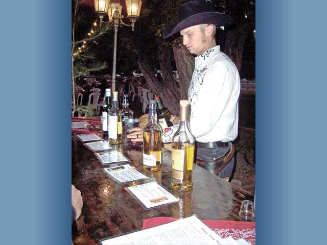 Noah Heter was the Scotch expert at the popular whiskey-tasting bar offered at the event.
