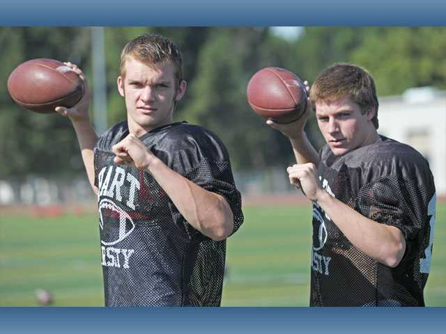 Hart football has gotten off to a 4-1 start this season thanks in part to the dual quarterback system of senior Cory Mayes, left, and sophomore Connor Wingenroth.