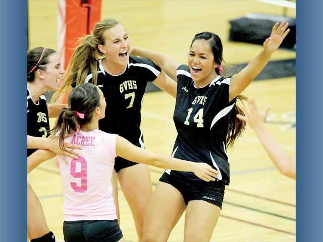 Golden Valley's Hanna Acree (9), Katie Nicholson (3), Sam Jennings (7) and Pia Franco (14) celebrate as Golden Valley won its first Foothill League match since Oct. 21, 2008.
