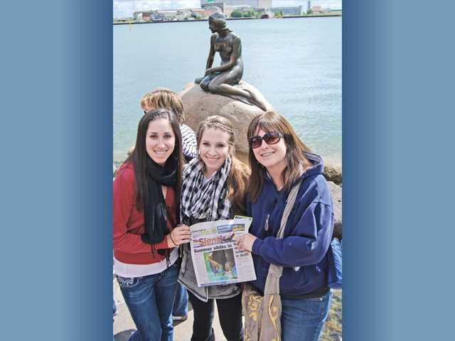 Dalia, Marlee and Lori Feinholz, of Valencia, stand in front of a mermaid statue in Copenhagen, Denmark, on June 25. The statue was commissioned in 1909, and is only 1.37 yards tall and about 386 pounds.
