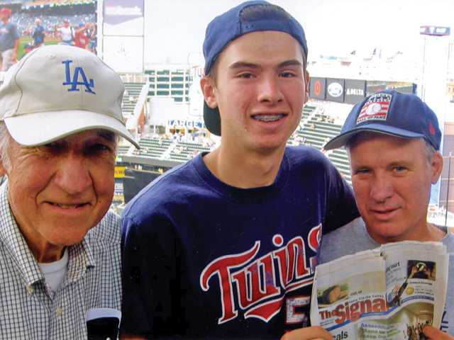 John, Brady and Steve Fuller pose at Target Field in Minneapolis, Minn., during a game between the Minnesota Twins and San Diego Padres in June.