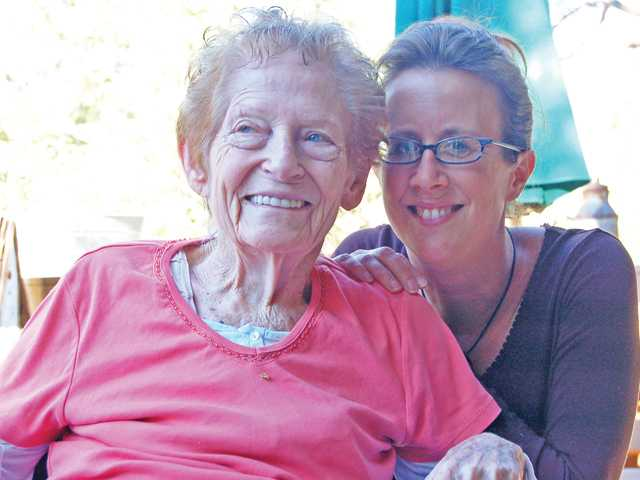 Signal Assistant Features Editor Michelle Sathe, right, poses with Lois Hollisert, an 83-year old woman who she bonded with during her week as a caregiver in Pine Mountain Club in Frazier Park.