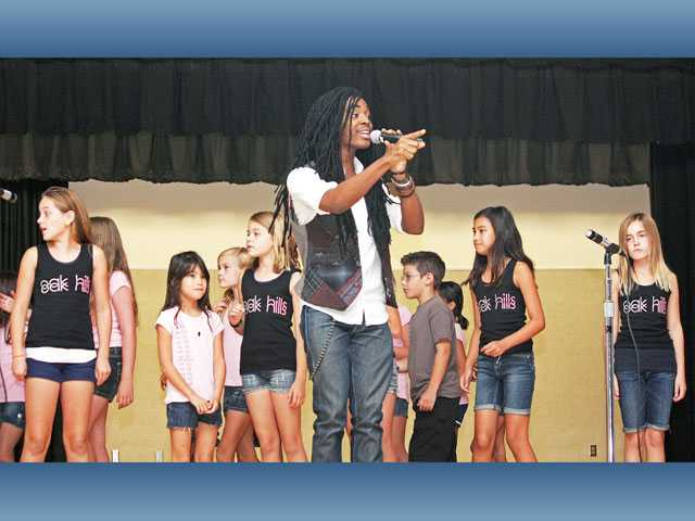 Ruba Wilson of Ruba's World Host gets Oak Hills Elementary School students excited about the Oct. 28 jog-a-thon during a kickoff assembly in September.