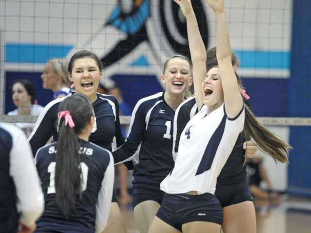 Members of the Saugus girls volleyball team celebrate their victory over Valencia on Tuesday at Saugus High School.