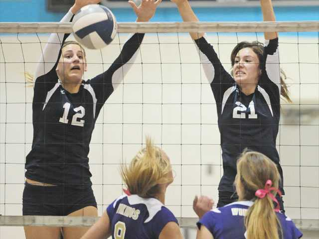 Saugus' Sarah Blomgren (12) and Taylor Edwards (21) block a kill attempt by Valencia's Sydney Striff (9) as Vikings teammate Delaney Knudsen looks on Tuesday at Saugus High School. The Centurions beat Valencia 3-1.
