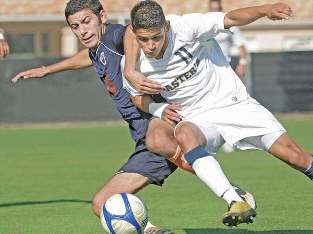 The Master's College's Jorge Serrano, right, takes the ball from Fresno Pacific's Alexis Hernandez on Wednesday at Reese Field.