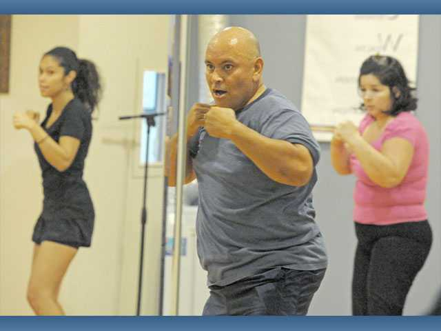 Pastor Gilbert Burns, center, leads a Living Faith Cardio class at the Santa Clarita Christian Center in Valencia on Tuesday.