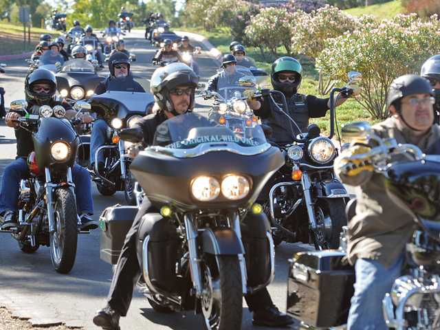 Motorcyclists arrive at Castaic Lake for the destination of the Love Ride on Sunday.
