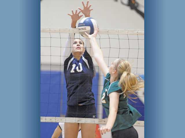 Saugus' Jaclyn Clark (10) blocks a shot by Canyon's Courtney Spackman on Tuesday at Saugus High School.