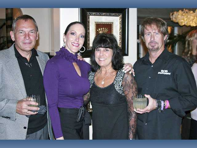 "Left to right, Chris Alkdiere of the Hyatt Regency Valencia; hostess Shelley Hann, Janet Yessayan of Classic Design Jewelry and Ed Masterson of SOS Entertainment at the ""Day in Her Shoes"" book party held at Hann's Westridge home. The book benefits the Domestic Violence Center of the Santa Clarita Valley."