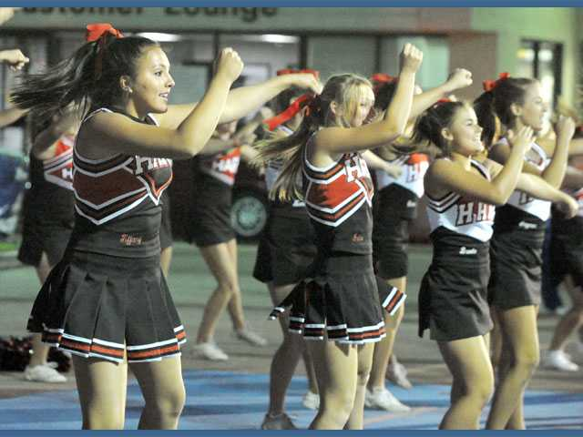 Hart High cheerleaders drum up support during a pep rally at Power Ford Valencia on Wednesday.