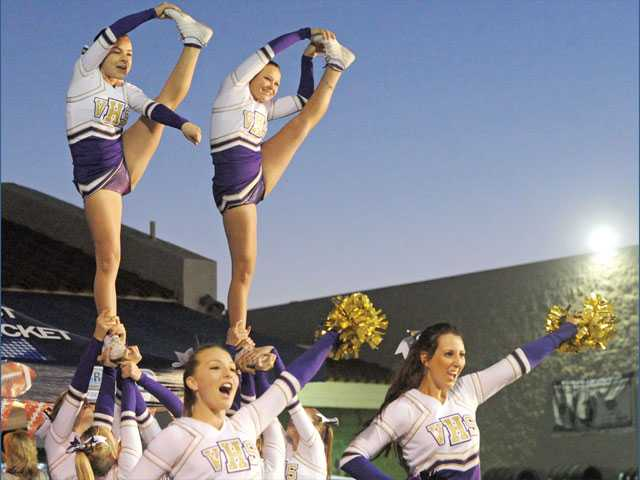Valencia High cheerleaders perform at the pep rally Wednesday.