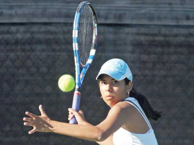 West Ranch No. 1 singles player Ana Cecilia Fuentes eyes the ball for a return on Wednesday at West Ranch High. Fuentes swept her three sets on the day.