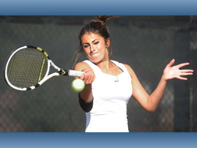Valencia's Brigitta Benitez returns a shot on Thursday against Golden Valley at Valencia High School.