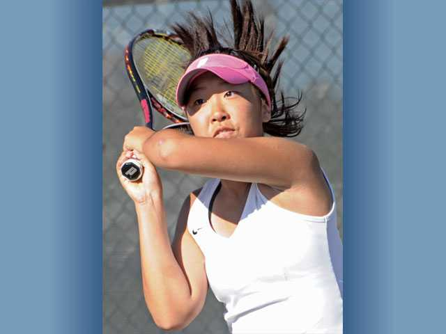 Golden Valley singles player Rebecca Ho returns a shot on Thursday at Valencia High.