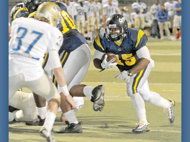 College of the Canyons running back Matt Bowen runs the ball against Allan Hancock College on Oct. 22 at College of the Canyons.