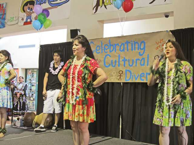 Halau Hula O Kanoelani, a Polynesian dance troupe, perform during a cultural awareness event on Oct. 14 at the Boys & Girls Club in Newhall.