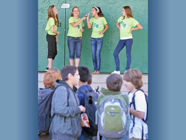 From left, eighth-graders Katrina Williams, Rachel Cook, Kimberly Sink and Amber Moynagh, all 13, encourage students to participate in Mix It Up Day.