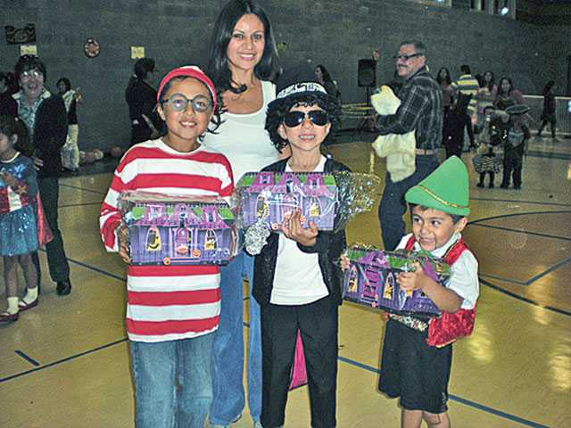 This year for the first time in history, one family got all first-place prizes in the best costume contest. Right to left, Joshua (Waldo), mother Blanca Herrejon, Nicholas (Michael Jackson) and Samuel (Pinocchio).