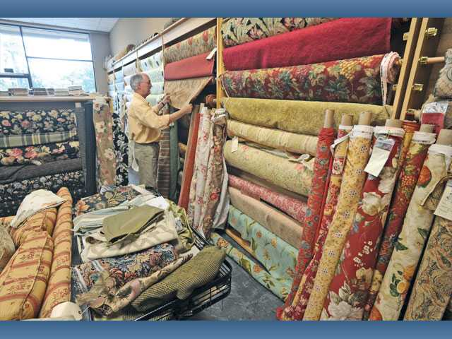 Tom Fisk, owner of Coming Home Fabrics in Valencia, has a variety of fabrics on display. The storefront will close at the end of the year, but custom fabric services will be offered online.