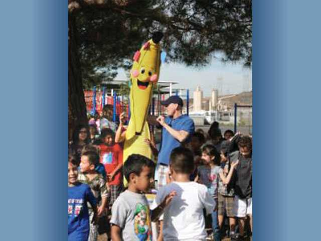 "Rio Vista Elementary School students celebrate their ""Top Banana"" award that they earned as part of the school's Race to the Top fundraiser. The students recently collected more than $15,000 in pledges as part of the school fundraiser."