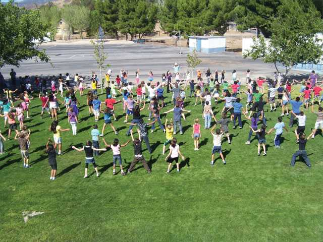 Agua Dulce Elementary School students do jumping jacks for one minute, joining first lady Michelle Obama's attempt to set a new Guinness World Record.