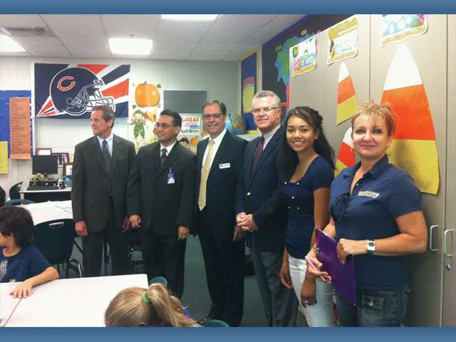From left, Newhall School District Superintendent Marc Winger, Oak Hills Elementary School Principal Luis M. Gamarra, West Ranch High School Principal Bob Vincent, Hart district superintendent Rob Challinor, West Ranch student Alyssa Smith and health teacher Terri Sage observe an Oak Hills Elementary School class on Oct. 18.