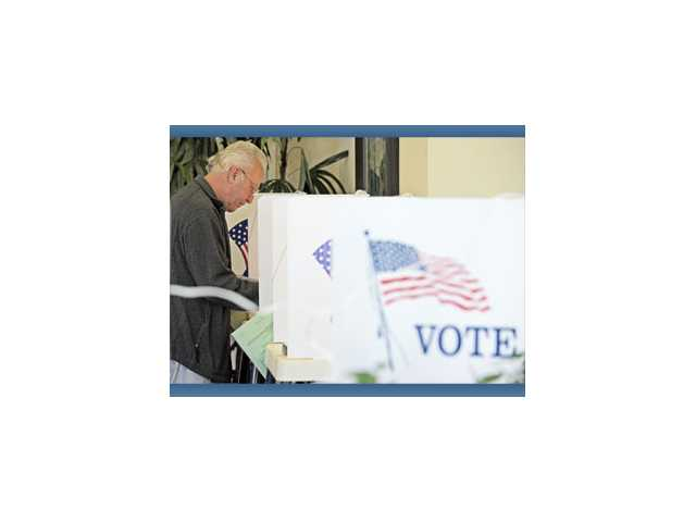 Glenn Karrasch, 64, of Sunset Pointe, casts a ballot in the clubhouse in Fountain Glen at Stevenson Ranch Apartments on Tuesday.