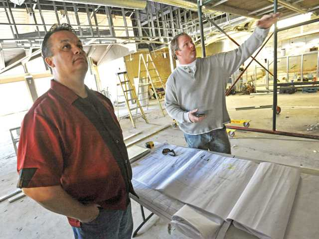 John Fisher, left, and John Grady of Grady Construction & Development discuss plans for the new Tilted Kilt Pub & Eatery as it is constructed in Valencia on Tuesday.