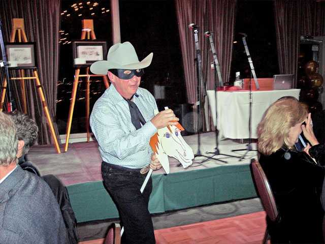 "Hicken rode into the banquet room astride his trusty ""steed"" Silver to the soundtrack of ""The Lone Ranger."""