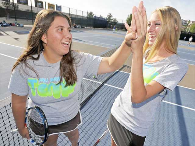 Valencia's Shenelle Trujillo, left, and Michelle Savage, right, have been best friends since the first grade and have teamed up this season to lead the Vikings' doubles side.