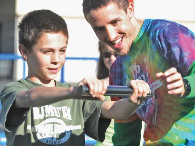 Fifth-grader Max Jonsson, left, holds onto a heart rate meter as exercise instructor Steve Erickson checks his heart rate. See A6 for more photos.