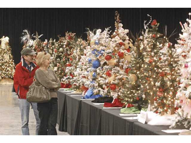 Guests to a previous Festival of Trees view the numerous tabletop trees for sale. This year's event begins tonight with a special VIP Preview. Festival of Trees will continue through Nov. 23 at Westfield Valencia Town Center at The Patios, adjacent to Sears. This is the ninth year of the family-friendly event.