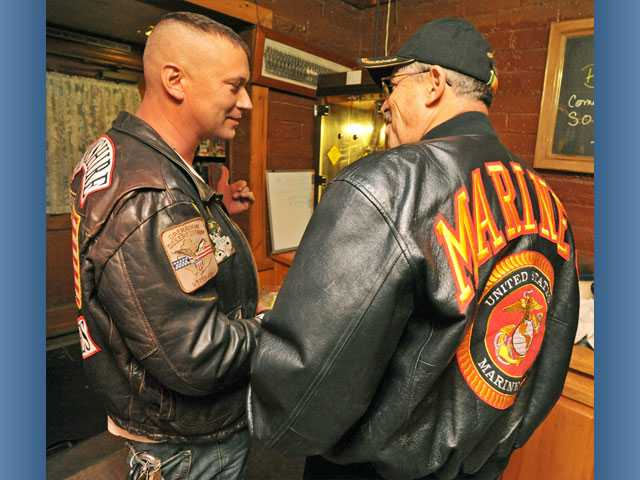 Marine veterans Thomas Case, left, and Dale Turner converse during a birthday celebration for the United States Marine Corps at the Veterans of Foreign Wars hall in Canyon Country on Thursday.