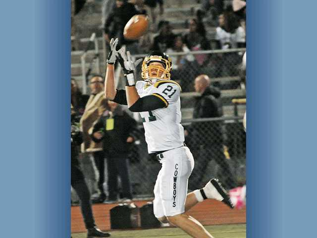 Canyon wide receiver Drew Wolitarsky hauls in a touchdown pass in the second quarter at Canyon High School on Thursday. The Cowboys defeated Golden Valley 48-21 and claimed at least a share of the Foothill League title.