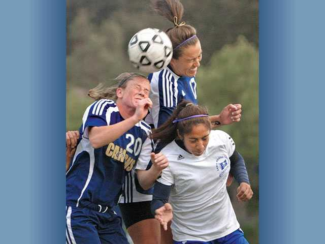 College of the Canyons Hannah Cooke (20) and Jessica Heade (17) head toward the goal the ball on Friday at COC.