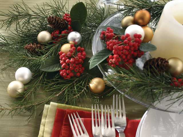 A festive table setting styled by Zelda Gordon. After the holidays are over, designers say pine branches can be used in home decor all winter.