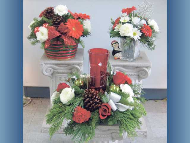 Christmas floral arrangements available at Steve's Valencia Florist, left to right, seasonal basket $45; Starbright centerpiece $72.95 and Send a Hug Penguin Bouquet $40.