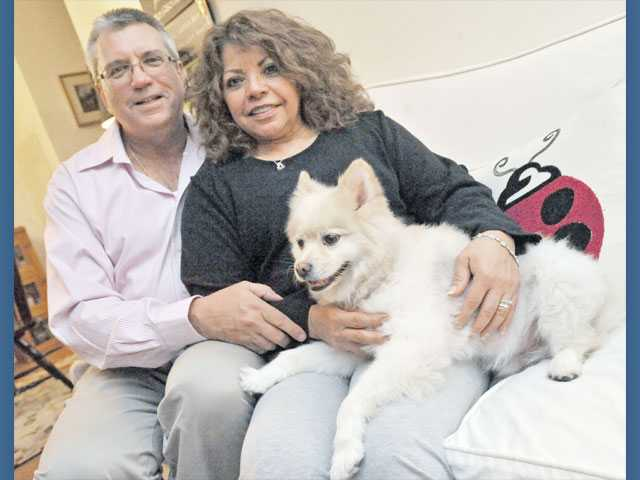 North with wife, Nancy, and their Pomeranian mix Wiley in their Canyon Country home.