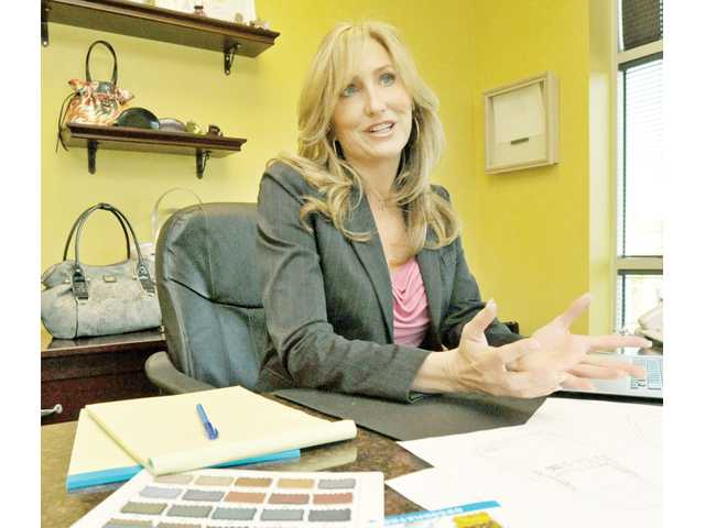 Susan Handley, founder, designer and president of Beijo Inc., discusses her product lines in her Santa Clarita office.