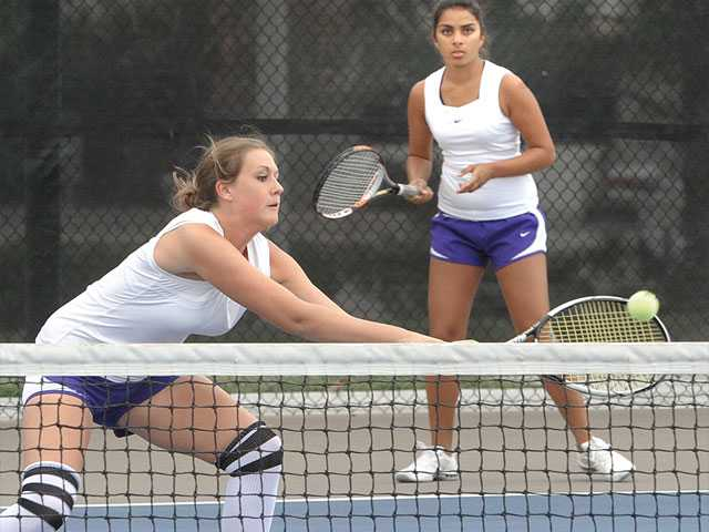 Valencia High doubles players Jenny Miller, left, and Alekhya Bommireddipalli try to return the ball against Upland High on Saturday at Valencia High School.