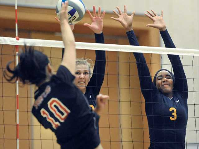 College of the Canyons teammates Jennie Long (19), and Michelle Nixon(3), block a shot by Fujii Sakurako (10) of Pierce College at College of the Canyons on Tuesday. Pierce won the match 3-0.