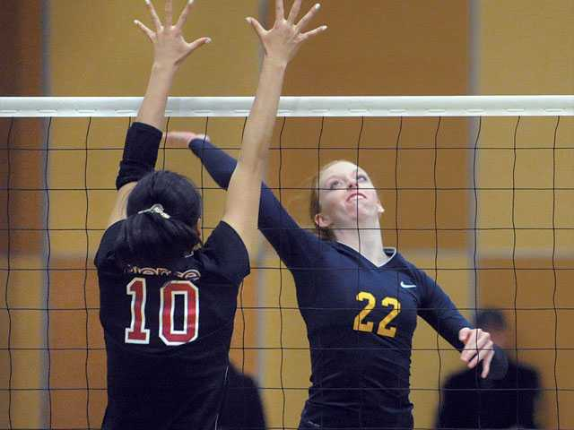 Kelsea Hundtoft (22), of College of  the Canyons, spikes against Fujii Sakurako (10), of Pierce College, at College of the Canyons on Tuesday. Pierce  defeated the Cougars 3-0.