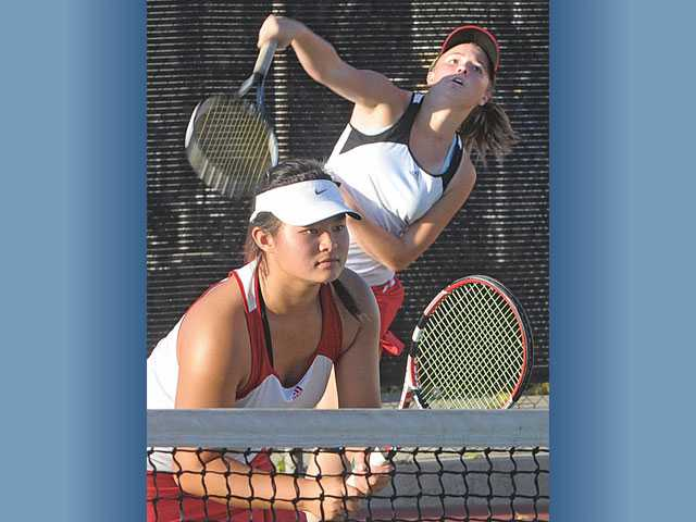 Hart's No. 2 doubles team of Lauren Dam, left, and Bailey Sindle, right, compete against St. Margaret's at Hart on Tuesday.