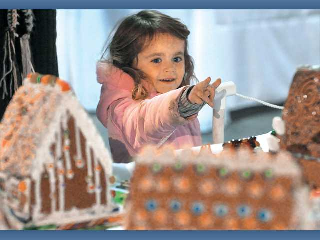 Savannah Laney, 3, points out her favorite gingerbread house.