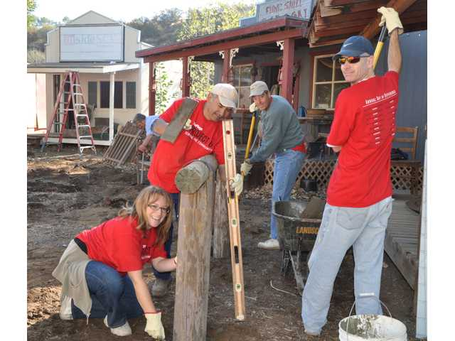 Six Flags Magic Mountain employees participate in Project 6, the company's annual day of service, at Carousel Ranch in Santa Clarita. Nationally, the company's employees joined with more than 50 service organizations to help out those less fortunate.