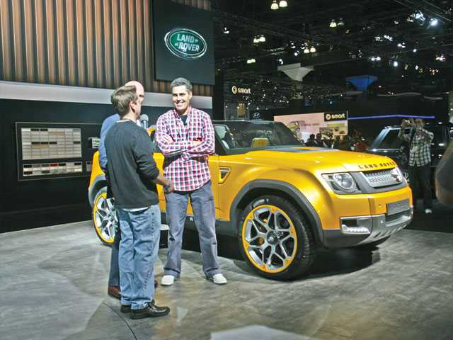 Celebrity Adam Carolla, right, speaks with members of the media during press days at the L.A. Auto.