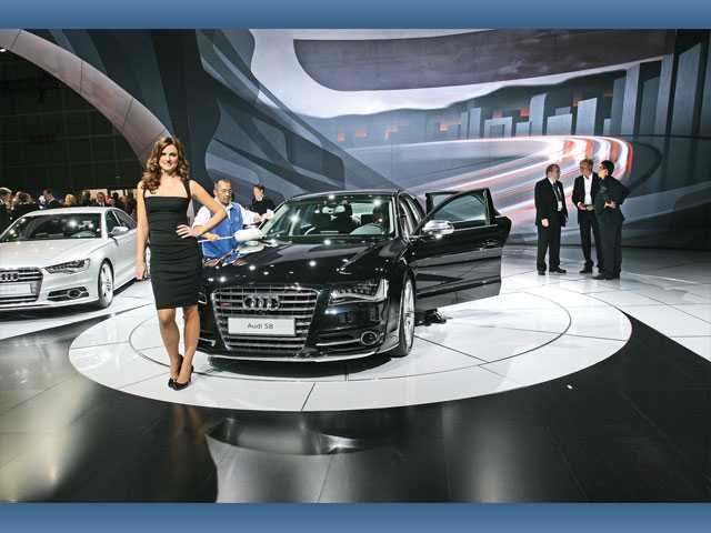 A model poses next to an Audi S8 which made its North American debut Wednesday at the L.A. Auto Show at the Los Angeles Convention Center.