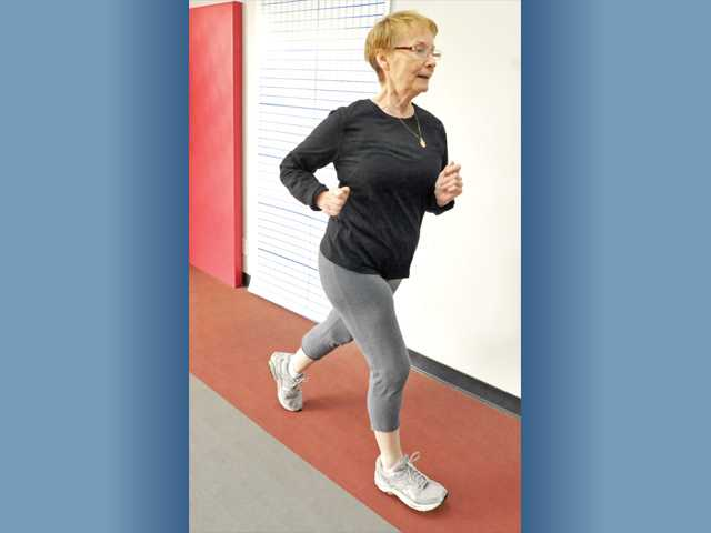 Results Fitness client Marty Strawser jogs to warm up for her workout. Regular exercise is crucial to staying fit during the holiday season.