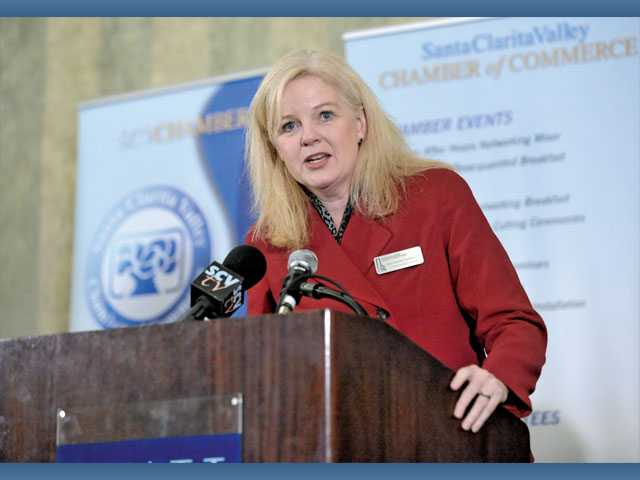 Dana Heimdahl Chernault, an affiliate of Smart Business Evolution, speaks during a panel discussion at the SCV Chamber of Commerce Luncheon held at the Hyatt Regency Valencia.